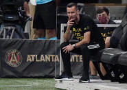 Atlanta United interim manager Stephen Glass watches the first half of an MLS soccer match against Nashville SC, Saturday, Aug. 22, 2020, in Atlanta. (AP Photo/Brynn Anderson)
