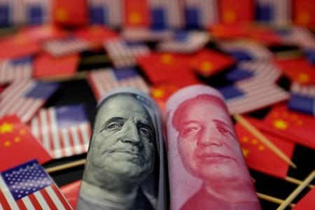 FILE PHOTO: Illustration picture showing U.S. dollar and China's yuan banknotes