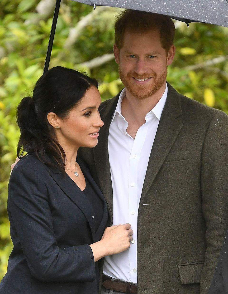 <p>The weather wasn't always great during the couple's royal tour but they took it in their stride. Meghan was seen cuddling into her husband under an umbrella on a visit to the North Shore in New Zealand.</p>