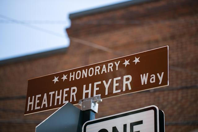 <p>A street sign renamed in honor of Heather Heyer is seen Aug. 10, 2018 in Charlottesville, Va., a year after she was killed while protesting a Unite the Right rally. (Photo: Logan Cyrus/AFP/Getty Images) </p>