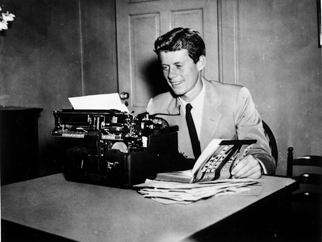 "<p>John F. Kennedy at a typewriter with his book ""Why England Slept,"" circa 1940. (Photo: John F. Kennedy Presidential Library and Museum) </p>"
