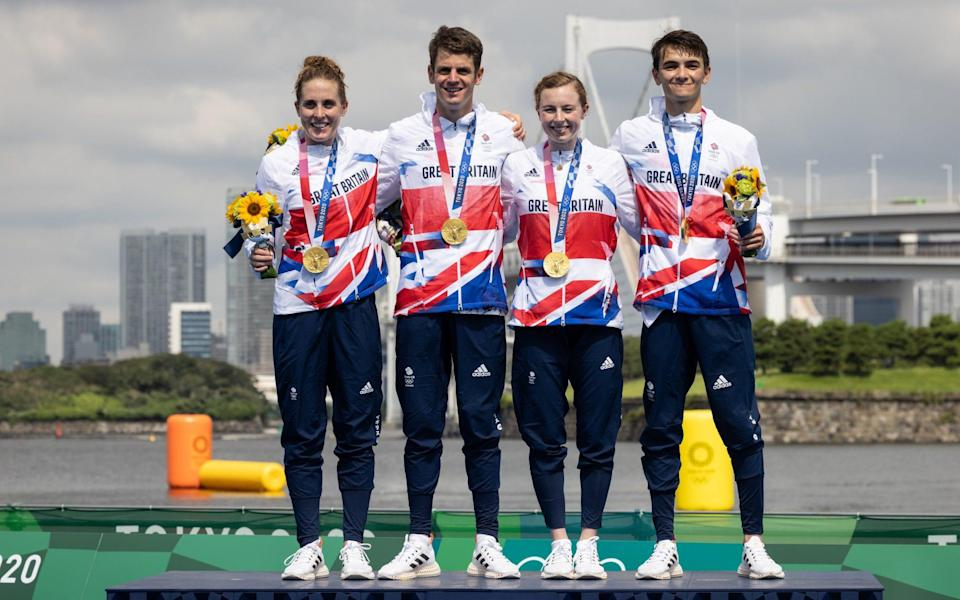 Jessica Learmonth, Jonny Brownlee, Georgia Taylor-Brown and Alex Yee of Team Great Britain celebrate on the podium during the medal ceremony following the Mixed Relay Triathlon on day eight of the Tokyo 2020 Olympic Games at Odaiba Marine Park on July 31, 2021 in Tokyo, Japan. - GETTY IMAGES