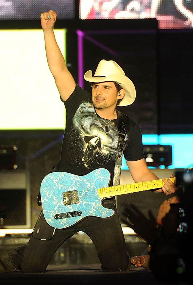 "Country king Brad Paisley learned to play guitar, a Sears Danelectro Silvertone, from his grandfather at age 8. By 10, he was performing in front of people at church, and by last November, at his current age of 38, he was named ""Entertainer of the Year"" at the CMA Awards. Rick Diamond/<a href=""http://www.gettyimages.com/"" target=""new"">GettyImages.com</a> - June 25, 2011"