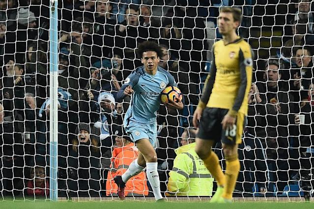 Manchester City's midfielder Leroy Sane (C) celebrates scoring on December 18, 2016 (AFP Photo/Oli SCARFF )