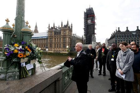 FILE PHOTO: Members of the public pay their respects on Westminster Bridge on the anniversary of the terror attack in London, Britain, March 22, 2018. REUTERS/Henry Nicholls/File Photo