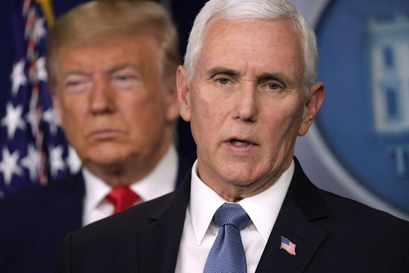 Mike Pence deleted a tweet praising Donald Trump's handling of the coronavirus as the official US death toll approaches 192,000. (Getty Images)
