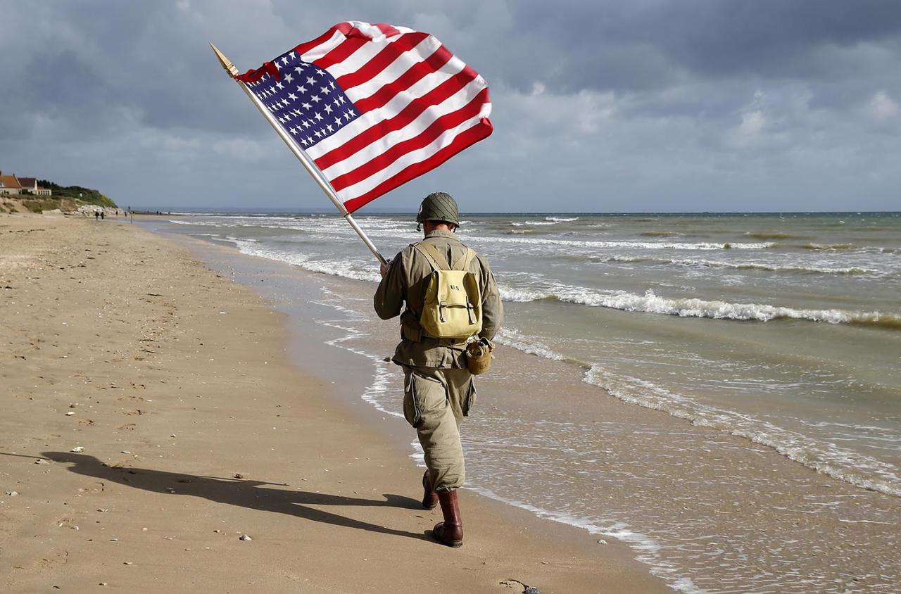 <p>A man dressed with U.S. 101st Airborne Division military uniforms walks on the beach during commemorations marking the 73th anniversary of D-Day. Many people gather On June 6 each year in Normandy to mark the anniversary of World War II's D-Day landing. (Photo: Chesnot/Getty Images) </p>