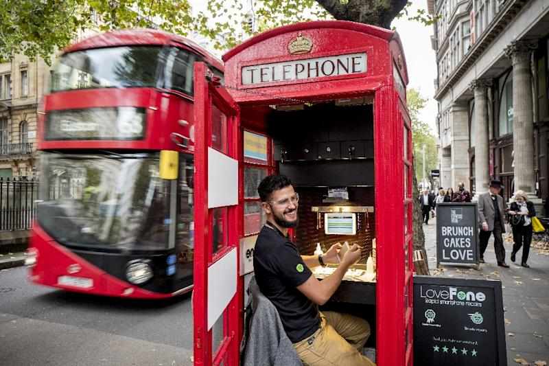 Fouad Choaibi transformed a London telephone box into Lovefone, a mobile phone repair business (AFP Photo/Tolga Akmen)