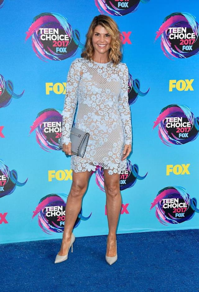 <p>Major legs and lace from the ageless <i>Fuller House</i> star, who accessorized her sweet dress with a studded clutch to add a touch of edge. (Photo: Getty Images) </p>