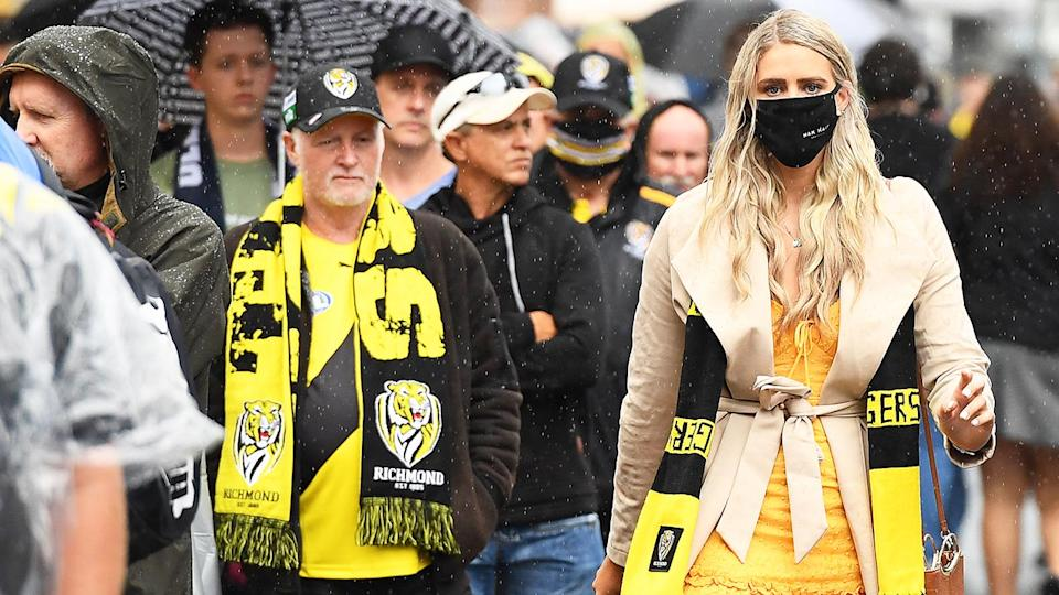 AFL fans, pictured here entering the Gabba before the 2020 AFL grand final.