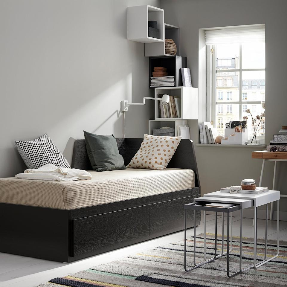 <p>The backrest on the <span>Flekke Daybed Frame With Two Drawers </span> ($349) is a game changer and works well for transitioning a small bedroom into a casual rest area.</p>
