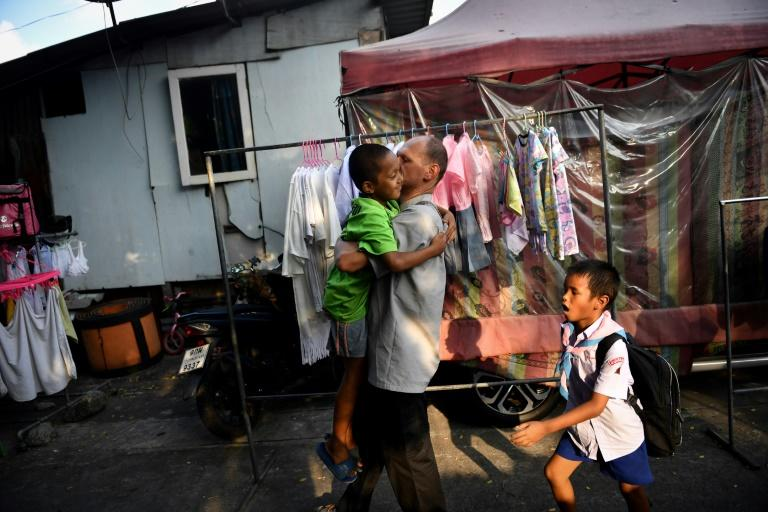 Father Alessio Crippa has been working to give children access to education and healthcare for the past three years in Khlong Toei, central Bangkok's largest slum and home to some 100,000 people (AFP Photo/Lillian SUWANRUMPHA)