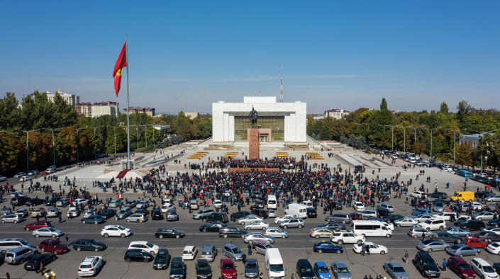 Protesters take part in a rally against the appointment of opposition politician Sadyr Japarov as the country's new prime minister, at Ala-Too Square, in Bishkek, Kyrgyzstan. (Akylbek Batyrbekov / Sputnik via AP)