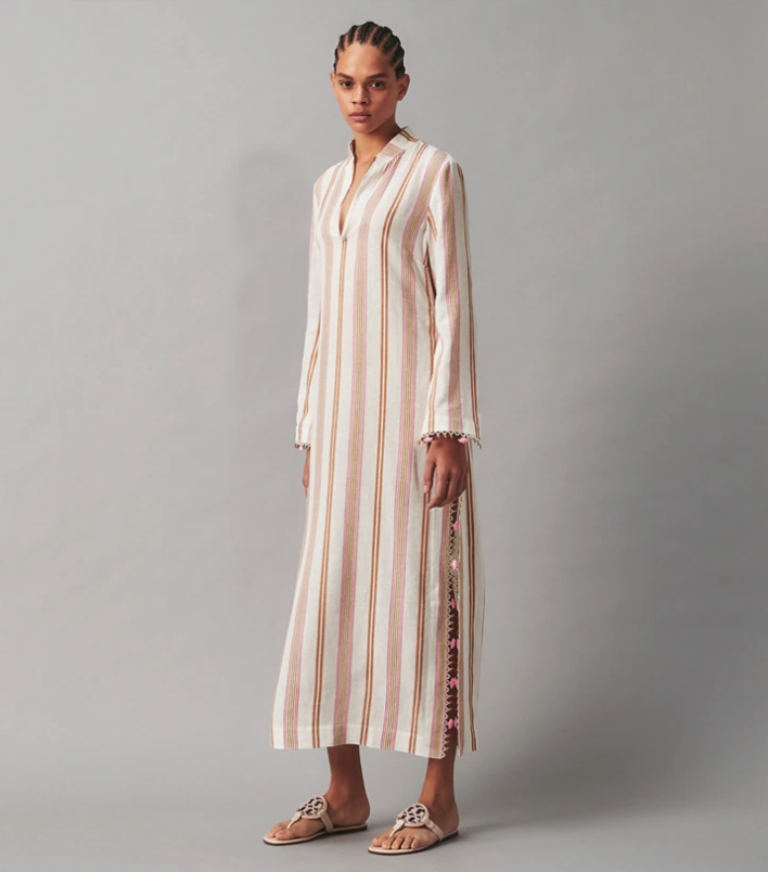 """<p><strong>Tory Burch</strong></p><p>toryburch.com</p><p><a href=""""https://go.redirectingat.com?id=74968X1596630&url=https%3A%2F%2Fwww.toryburch.com%2Fen-us%2Fswim%2Fcoverups%2Fstephanie-beach-caftan%2F76894.html%3Fcolor%3D079&sref=https%3A%2F%2Fwww.townandcountrymag.com%2Fstyle%2Ffashion-trends%2Fg36755206%2Ftory-burchs-semi-annual-sale-june-2021%2F"""" rel=""""nofollow noopener"""" target=""""_blank"""" data-ylk=""""slk:Shop Now"""" class=""""link rapid-noclick-resp"""">Shop Now</a></p><p><strong><del>$458</del> $254 (44% off)</strong></p><p>A scenic beach vacation deserves an equally stunning wardrobe. Slip into this breezy caftan, which will look as at the beach as it does at the bar.<strong><br></strong></p>"""