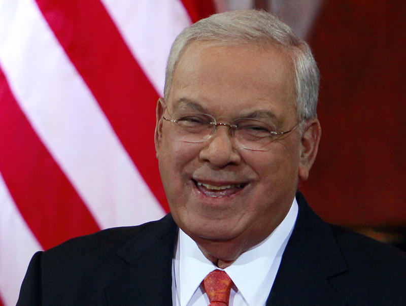 Boston Mayor Tomas Menino smiles during applause at Faneuil Hall in Boston, Thursday, March 28, 2013, where he announced he would not seek an unprecedented sixth term. The 70-year-old mayor was treated for a respiratory infection that developed during a vacation in Italy. While in the hospital he suffered complications including a compression fracture in a vertebra in his spine and was diagnosed with Type 2 diabetes. After being discharged, he spent three months recuperating at a city-owned mansion on Beacon Hill. before returning to his home.  (AP Photo/Bill Sikes)