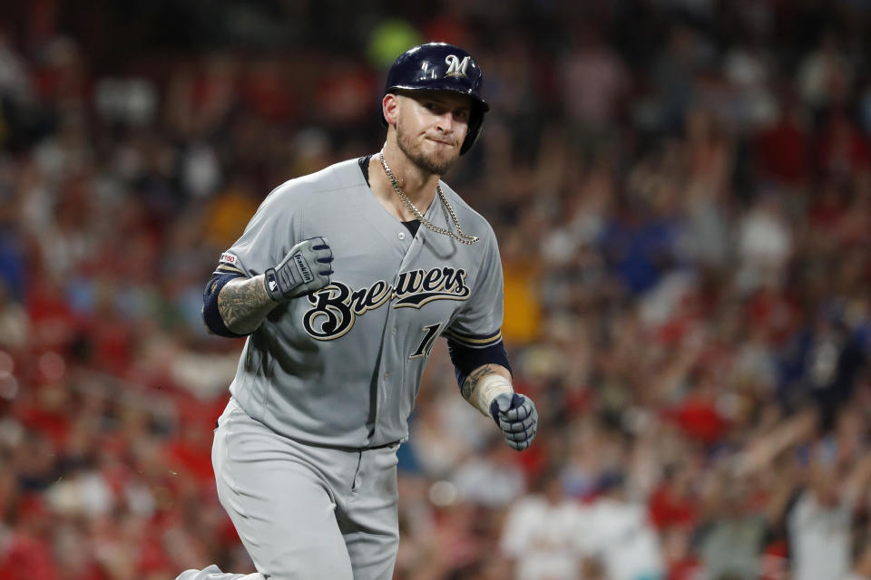 Milwaukee Brewers' Yasmani Grandal pumps his fist as he rounds the bases after hitting a two-run home run during the eighth inning of a baseball game against the St. Louis Cardinals, Saturday, Sept. 14, 2019, in St. Louis. (AP Photo/Jeff Roberson)