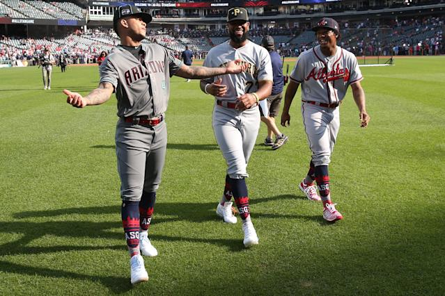 Ketel Marte #4 of the Arizona Diamondbacks, Felipe Vazquez #73 of the Pittsburgh Pirates and Ronald Acuna Jr. #13 of the Atlanta Braves are seen on the field prior to the 90th MLB All-Star Game at Progressive Field on Tuesday, July 9, 2019 in Cleveland, Ohio. (Photo by Rob Tringali/MLB Photos via Getty Images)