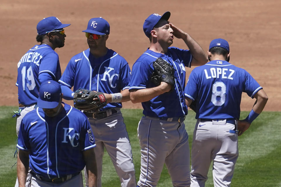 Kansas City Royals pitcher Kris Bubic, middle right, reacts on the mound during the second inning of a baseball game against the Oakland Athletics in Oakland, Calif., Sunday, June 13, 2021. (AP Photo/Jeff Chiu)