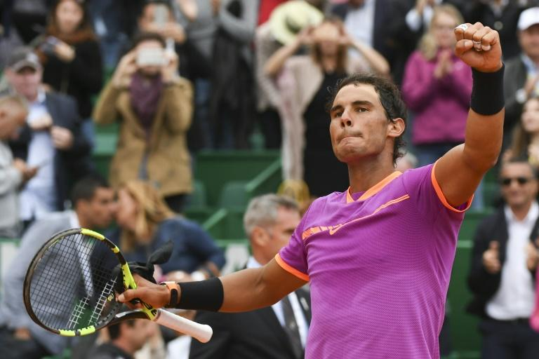 Spain's Rafael Nadal celebrates after winning against Britain's Kyle Edmund during the Monte Carlo ATP Masters Series tournament tennis match on April 19, 2017 in Monaco