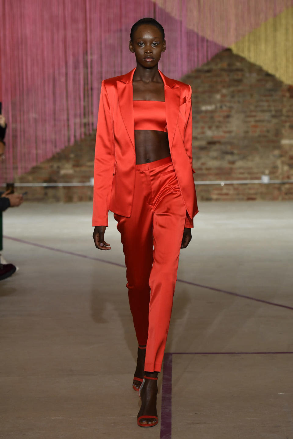 <p>Model wears a red pantsuit at the fall 2018 Milly show. (Photo: Getty Images) </p>