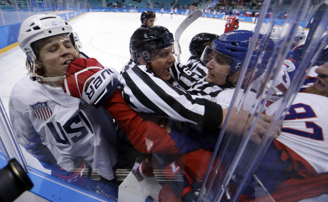 <p>Referees break up fight between the United States and the Czech Republic players during the first period of the quarterfinal round of the men's hockey game at the 2018 Winter Olympics in Gangneung, South Korea, Wednesday, Feb. 21, 2018. (AP Photo/Matt Slocum) </p>