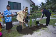 <p>When in Tuvalu, plant a coconut tree. With traditional floral garlands around their necks, the newlyweds helped to dig holes during their debut post-wedding Diamond Jubilee tour of the Far East in 2012. <em>[Photo: Getty]</em> </p>
