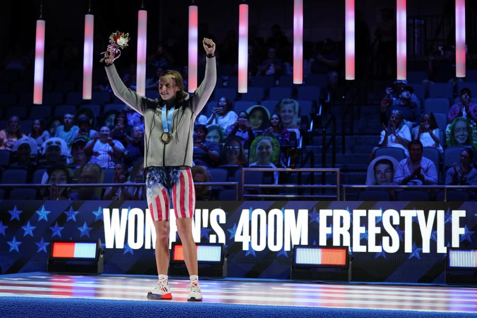 Katie Ledecky reacts at the medal ceremony after winning the Women's 400 Freestyle during wave 2 of the U.S. Olympic Swim Trials on Monday, June 14, 2021, in Omaha, Neb. (AP Photo/Charlie Neibergall)