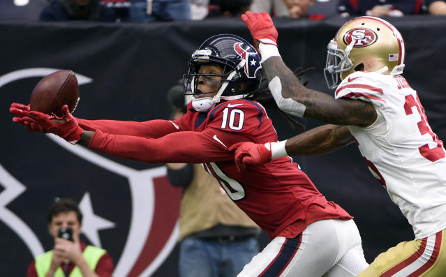 <p>Houston Texans wide receiver DeAndre Hopkins (10) pull is a pass for a touchdown in front of San Francisco 49ers cornerback Dontae Johnson (36) during the first half of an NFL football game Sunday, Dec. 10, 2017, in Houston. (AP Photo/Eric Christian Smith) </p>