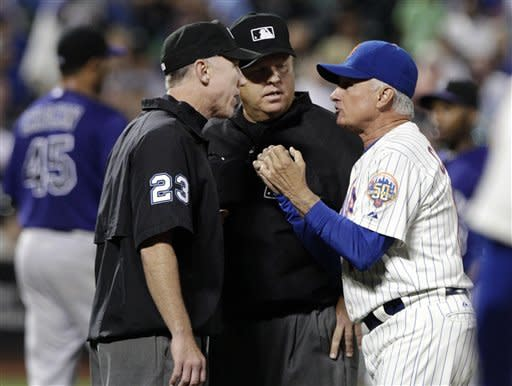 New York Mets manager Terry Collins, right, argues a call by umpires Lance Barksdale, left, and Fieldin Culbreth, center, during the fifth inning of a baseball game against the Colorado Rockies, Tuesday, Aug. 21, 2012, in New York. Collins was ejected after the discussion. (AP Photo/Frank Franklin II)