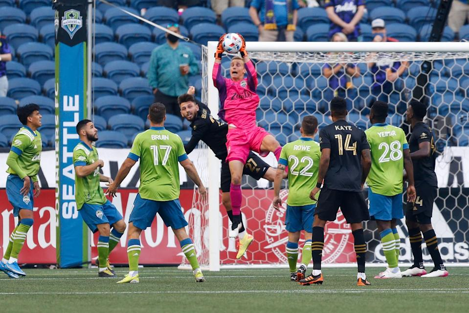 Seattle Sounders FC goalkeeper Stefan Cleveland makes a save during Sunday's win over LAFC.