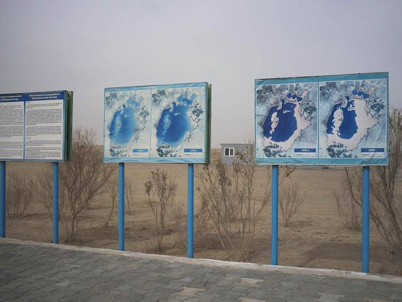 Signs in Muynak show the disappearance of the once vast body of water (Aleksandr Zykov)