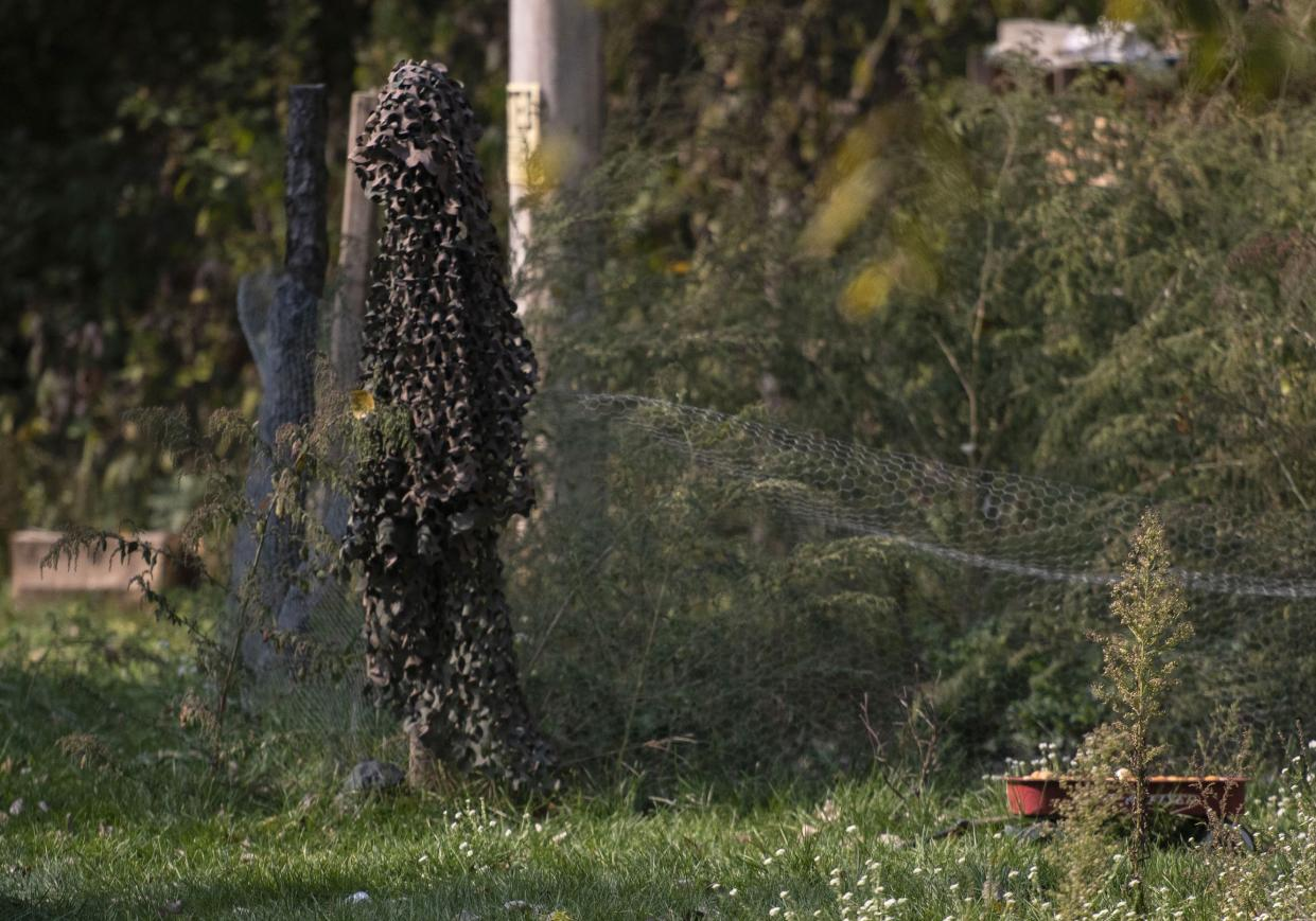 A ghillie suit (center) is seen hanging Oct. 9 in Munith, Mich., where law enforcement officials said suspects accused in a plot to kidnap Michigan Democratic Gov. Gretchen Whitmer met to train and make plans.