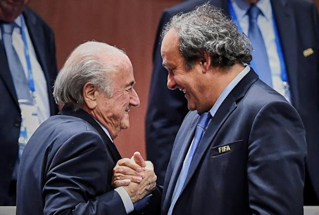 Sepp Blatter received the congratulations of Michel Platini after being re-elected on May 29, 2015 (AFP Photo/MICHAEL BUHOLZER)