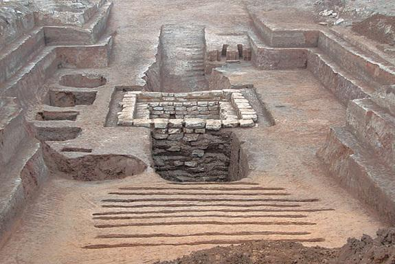 A panoramic view of the 2,300-year-old tomb (facing north), revealing two ramps that lead to a heavily robbed burial chamber.