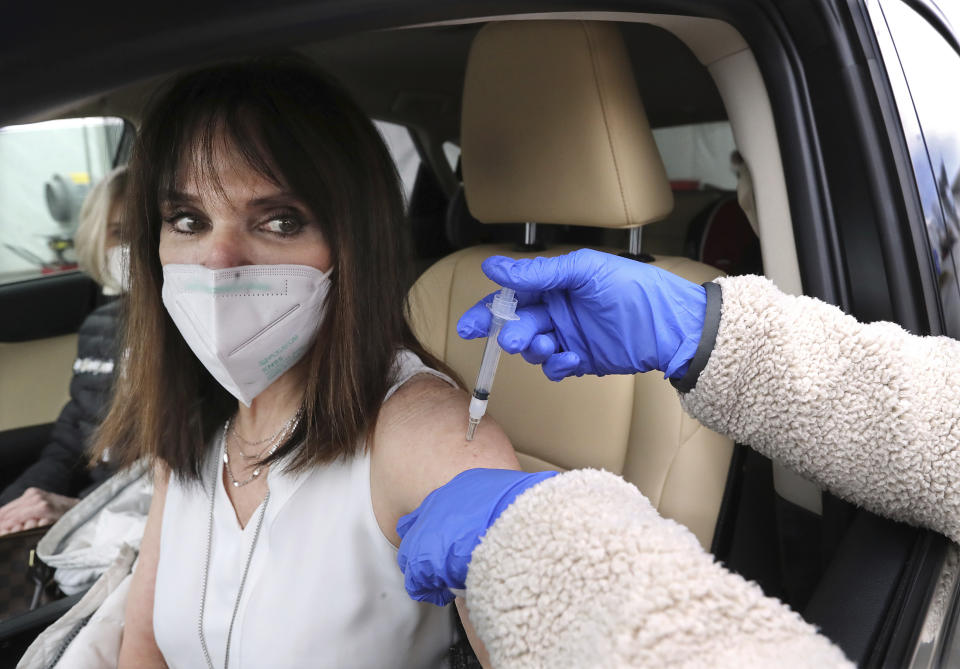 Nursing professor Pattie Troyan gets a Moderna COVID-19 vaccination at drive through testing site in Doraville, Georgia, US. Photo: Curtis Compton/Atlanta Journal-Constitution via AP