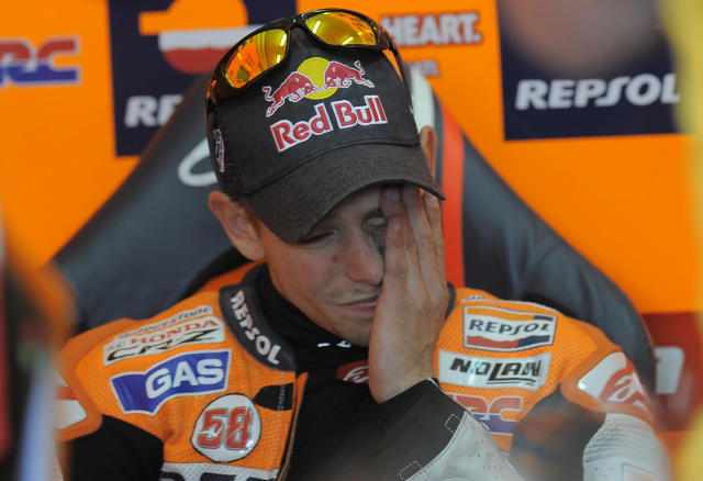 Repsol Honda Team's Australian Casey Stoner gestures in the pit during the Moto GP Training session of the Valencia Grand Prix at Ricardo Tormo racetrack in Cheste, on November 04, 2011. AFP PHOTO / JOSE JORDAN (Photo credit should read JOSE JORDAN/AFP/Getty Images)