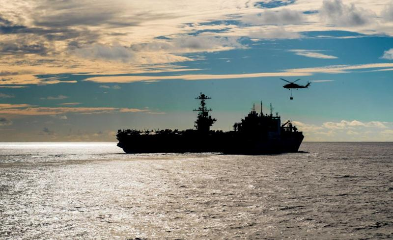 The Nimitz-class aircraft carrier USS John C. Stennis conducts a replenishment-at-sea with the dry cargo and ammunition ship USNS Charles Drew November 13, 2018. Picture taken November 13, 2018. Courtesy Nick Bauer/U.S. Navy/Handout via REUTERS ATTENTION