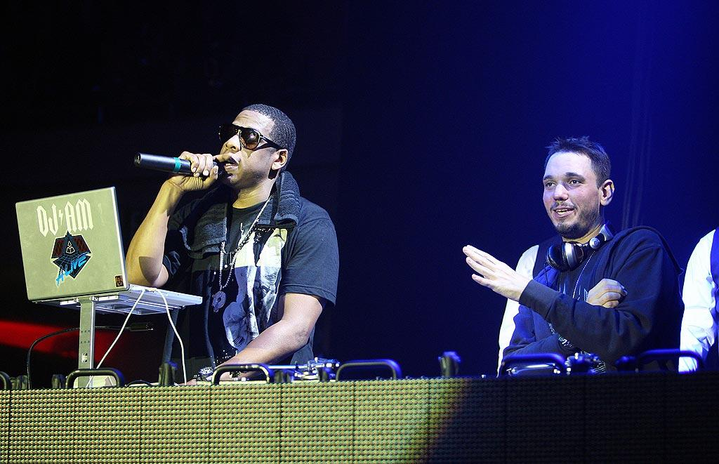 """DJ AM (Adam Goldstein) made a triumphant return to the stage Wednesday, his first performance since surviving a September plane crash that killed four. The disc jockey, still bearing burn scars, joined Jay-Z to celebrate the reopening of the Hollywood Palladium. Former Blink-182 drummer Travis Barker -- who also survived the crash -- was released from a LA burn center Friday. Frank Micelotta/<a href=""""http://www.gettyimages.com/"""" target=""""new"""">GettyImages.com</a> - October 15, 2008"""