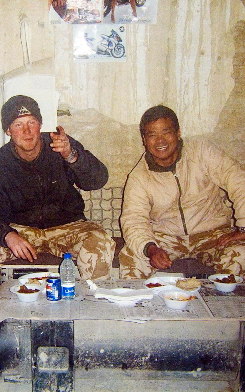 Prince Harry in Afghanistan with Captain Chandra Pun, eating a goat curry