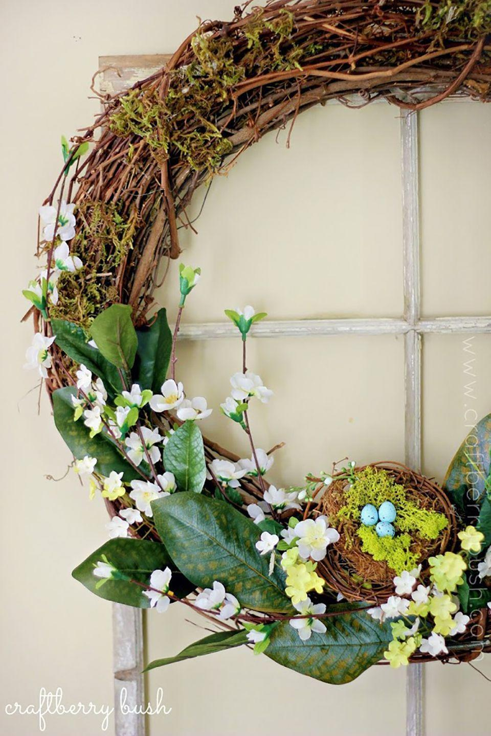 """<p>With moss, leaves, flowers, and a little bird's nest, this woodsy wreath embodies the spirit of spring.</p><p><strong>Get the tutorial at <a href=""""https://www.craftberrybush.com/2013/04/easy-spring-wreath.html"""" rel=""""nofollow noopener"""" target=""""_blank"""" data-ylk=""""slk:Craftberry Bush"""" class=""""link rapid-noclick-resp"""">Craftberry Bush</a>.</strong><br></p><p><strong><strong><a class=""""link rapid-noclick-resp"""" href=""""https://www.amazon.com/Bulk-Buy-Darice-Grapevine-Wreath/dp/B0033M0HG4?tag=syn-yahoo-20&ascsubtag=%5Bartid%7C10050.g.4088%5Bsrc%7Cyahoo-us"""" rel=""""nofollow noopener"""" target=""""_blank"""" data-ylk=""""slk:SHOP GRAPEVINE WREATHS"""">SHOP GRAPEVINE WREATHS</a></strong><br></strong></p>"""