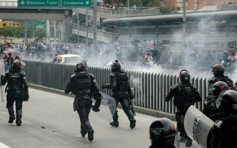 Riot police used tear gas to disperse demonstrators during anti-government protests