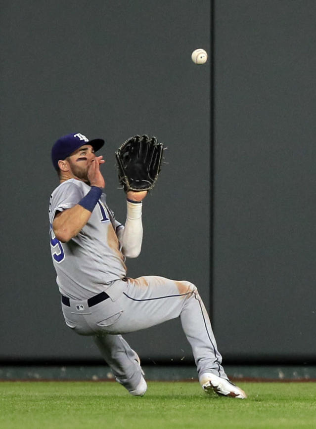 Tampa Bay Rays center fielder Kevin Kiermaier catches a fly ball hit by Kansas City Royals' Alex Gordon during the third inning of a baseball game at Kauffman Stadium in Kansas City, Mo., Monday, April 29, 2019. (AP Photo/Orlin Wagner)