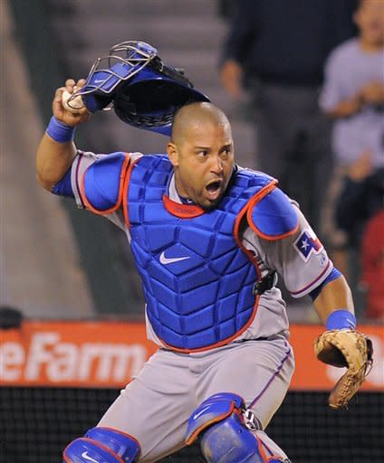Texas Rangers catcher Yorvit Torrealba reacts after Los Angeles Angels' Mike Trout was called safe at home on a sacrifice fly by Kendrys Morales during the seventh inning of their baseball game, Saturday, June 2, 2012, in Anaheim, Calif. Torrealba was thrown out of the game while arguing with the umpire on the play. (AP Photo/Mark J. Terrill)