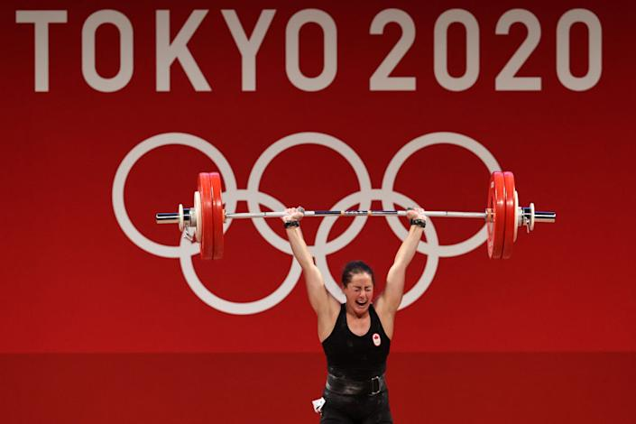 Charron became just the second Canadian woman ever to medal in weightlifting at the Olympics after taking gold in the 64kg event. (Getty Images)