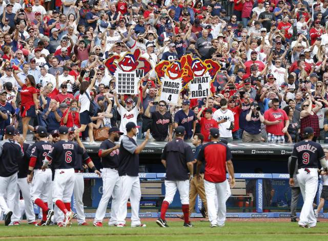 Cleveland Indians fans celebrate a 5-3 victory over the Detroit Tigers in a baseball game, Wednesday, Sept. 13, 2017, in Cleveland. The Indians set the American League record with 21 consecutive wins. (AP)
