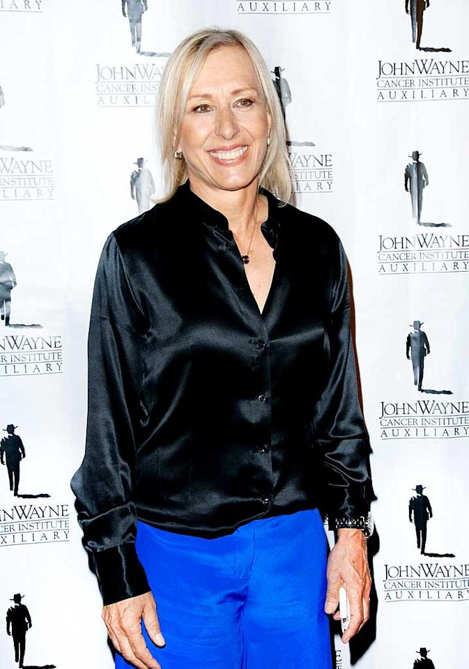 """<p class=""""MsoNormal""""><span style=""""font-size:10.0pt;"""">Shortly after becoming a U.S. citizen in the early '80s, tennis ace Martina Navratilova came out. In the years following her announcement, Navratilova ruled the pro circuit while dating author Rita Mae Brown, then Judy Nelson, her partner of seven years. The nine-time Wimbledon singles champ and Nelson broke up in 1991 (their split was highly publicized), but Martina has gone on to do many things since, such as becoming an animal and gay rights spokesperson. A vocal activist, she has fought discrimination laws in Colorado, was honored with the National Equity Award from the Human Rights Campaign, appeared in ads supporting PETA, denounced communism, and battled breast cancer in 2010. </span></p>"""