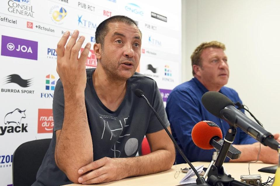 RC Toulon's president Mourad Boudjellal (L) and general director Patrick Bouquet answer journalists' questions during a press conference in Toulon, southern France, on September 8, 2015 (AFP Photo/Anne-Christine Poujoulat)