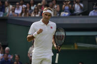 Switzerland's Roger Federer celebrates winning a point against Richard Gasquet of France during the men's singles second round match on day four of the Wimbledon Tennis Championships in London, Thursday July 1, 2021. (AP Photo/Alberto Pezzali)