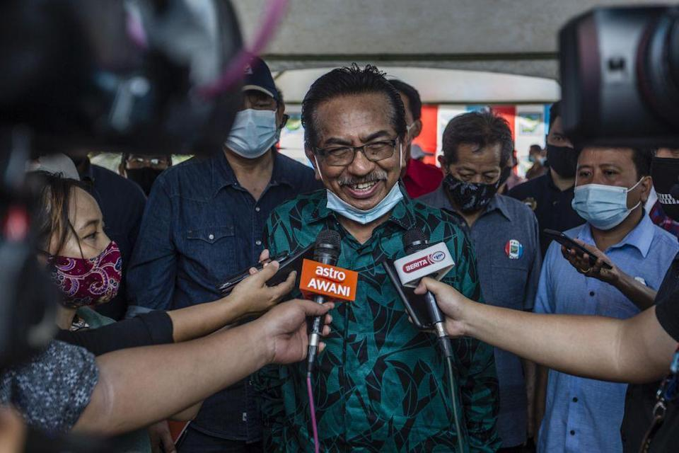 Former Sabah chief minister Tan Sri Musa Aman speaks to reporters while campaigning in Kiulu September 18, 2020. In an 'open letter to the people of Malaysia', Musa instead blamed the chief minister then, Datuk Seri Mohd Shafie Apdal, for calling a state election rather than 'handing back' the government to him. — Picture by Firdaus Latif