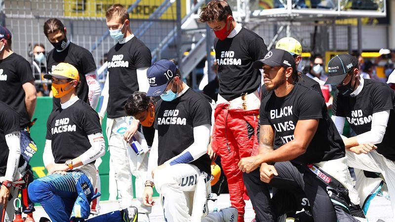 Seen here, drivers join Lewis Hamilton in taking a knee before the Austrian Grand Prix.